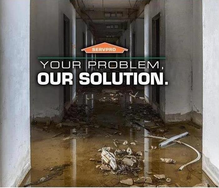 "Hallway with flooding, SERVPRO logo with words ""YOUR PROBLEM, OUR SOLUTION."""